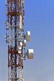 Communications tower. Communication tower with parabolic antennas Royalty Free Stock Images