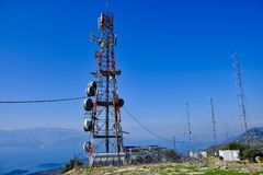 Communications Tower and Aerials on Greek Mountain. A large telecommunications tower and aerials on a Greek mountain overlooking the Gulf of Corinth, with royalty free stock images