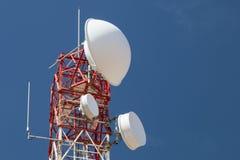 Communications Tower. A communications tower against blue sky Royalty Free Stock Photos