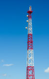 Communications Tower. Against Blue Sky, Gsm transmitter Stock Photography