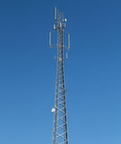 Communications tower with antennae. This is a communications tower with various antennae Stock Photography