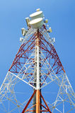 Communications tower with antennas against blue sky. Communications tower with antennas against Stock Photography
