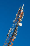 Communications tower with antennas Royalty Free Stock Images