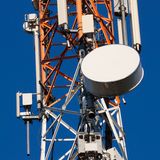 Communications tower with antennas on blue sky Royalty Free Stock Images