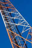 Communications tower with antennas on blue sky Stock Image