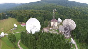 Communications tower and big satellite antennas. Location with big satellite antennas array and communications tower , electronic equipment for signal stock footage