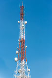 Communications tower with blue Cloud sky background. Communications tower with blue Cloud sky background Royalty Free Stock Photo