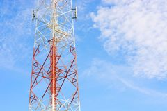 Communications tower. With blue Cloud sky background Royalty Free Stock Photos