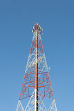 Communications tower with a blue sky Stock Photography