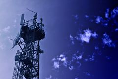 Communications Tower Blue Tone. Communications tower for mobile phones and television signals.  Blue toned Stock Images