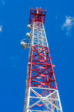 Communications Tower close-up. Communications tower against blue sky close-up, gsm transmitter Stock Photos