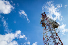 Communications Tower with cloud and blue sky Stock Images