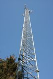 Communications tower in the forest with blue sky Royalty Free Stock Photos