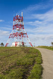 Communications tower 2. Low angle view of a four legged communications tower sitting on top of a hill Stock Photography