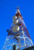 Communications tower in the meadow Royalty Free Stock Images