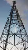 Communications tower pylon on sky background. In evening Royalty Free Stock Images