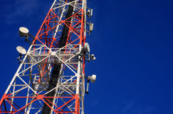 Communications tower and satellite on blue sky. Royalty Free Stock Image