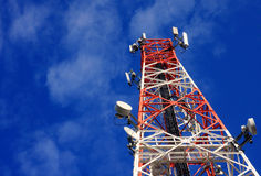 Communications tower and satellite on blue sky. Stock Image
