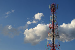 Communications tower and satellite on blue sky. Royalty Free Stock Images