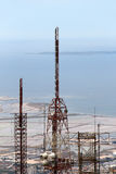 Communications towers, against the sea. A detailed view of the top part of some communications towers, against the sea of trapani, portrait cut Royalty Free Stock Photo