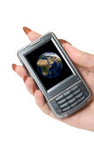 Communicator. Female hand hold communicator with planet earth at screen royalty free stock image