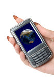 Communicator. Female hand hold communicator with planet earth at screen royalty free stock photography