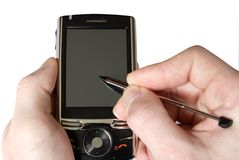 Communicator. Hands with communicator isolated over white background royalty free stock photo