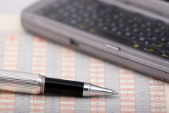 Communicator and pen on a chart. Phone, chart, pen Royalty Free Stock Photo
