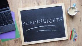 Communiceer geschreven stock foto