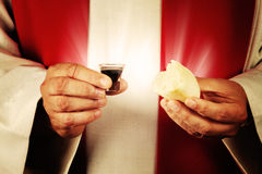 Communion. A minister of religion offering communion Stock Photos