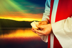 Communion. A minister of religion offering communion Royalty Free Stock Photo