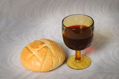 Communion. Symbolized by bread and wine Royalty Free Stock Image