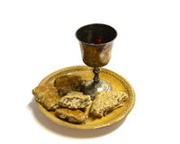 Communion. Unpolished vine cup and bread Stock Images