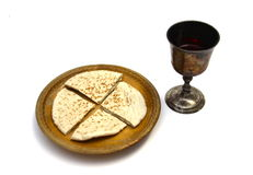 Communion. Unpolished vine cup and bread Royalty Free Stock Photography
