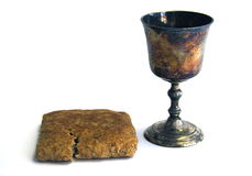 Communion. Unpolished vine cup and bread royalty free stock photos