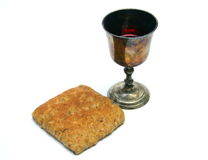 Communion. Unpolished vine cup and bread Royalty Free Stock Images