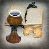 Communion. Red wine with book and bread Stock Images
