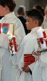 Communion. A young boy in the church holding the candle Royalty Free Stock Photo