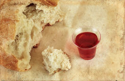 Communion Bread Loaf and Wine Grunge. Communion bread loaf and wine on a grunge background Stock Image