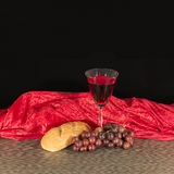 Communion Bread, Wine and Grapes Royalty Free Stock Image