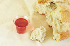 Communion Bread and Wine on White Background Royalty Free Stock Image