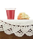 Communion Bread and Wine on White Background Stock Image