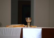 Communion in Catholic church. Preparing for communion in a Catholic Mass Royalty Free Stock Image