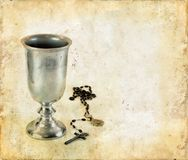 Communion Chalice and Rosary. Chalice for communion and a rosary on a grunge background stock photography