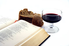 Communion concept. Open bible,wine and bread Stock Image
