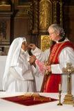 Communion dans l'église Photo stock
