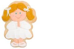 Communion de fille blonde de biscuit première Photos libres de droits