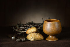 Communion Elements with Crown of Thorns and Nails. On vintage table royalty free stock photography