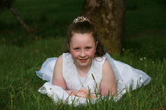Communion Girl. This is a photograph of a young girl about 7 years of age, its her first Holy Communion and it is a big day for her Stock Image