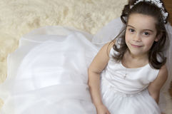 Communion Girl. Portrait of a little girl in communion dress and veil Stock Images